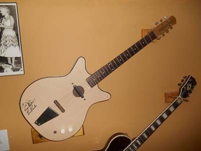 When the Danelectro isn't traveling around with Jim it rests on the wall in his basement.