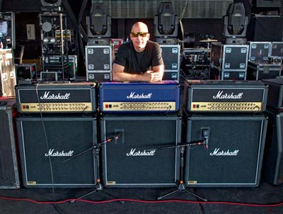 The one-and-only Satch with a trio of his signature heads – including a limited edition, blue one.